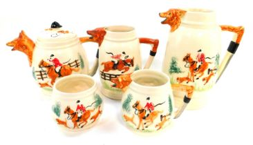 An early 20thC Portland Pottery Company pottery tea and coffee hunting service, moulded with fox mas