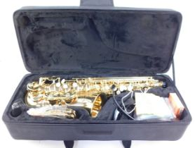 An Evette brass saxophone by Julius Keilwerth, with mother of pearl keys, serial no GEA60899, cased.