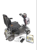 A Sterling Sapphire 2 four wheel mobility scooter, with leatherette seat, battery charger, front bas