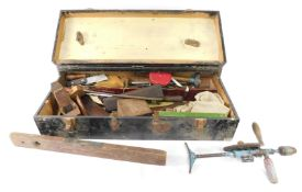 A carpenter's tool chest, including level, chisels, saw, block plane, Clipper drill, etc.