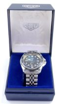 A Heuer gentleman's automatic 200m professional stainless steel case wristwatch, circular black dial