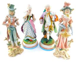 A pair of 19thC Continental bisque porcelain figures of a lady and gentleman, holding love birds, an