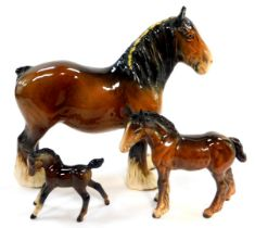 Two Beswick pottery foals, and a associated pottery shire horse. (3)