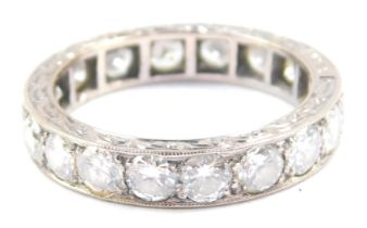 A diamond full eternity ring, set in white metal, stamped 18ct, approx 2.25cts, size P, 5.3g.