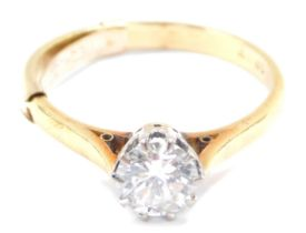 A diamond solitaire ring, high claw set in yellow metal, stamped 18ct, approx 1ct, size Q, 3.6g.