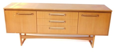 A Portwood Furniture vintage teak sideboard, with three central drawers flanked by a pair of cupboar