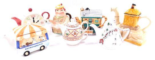 A group of character teapots, comprising a Tony Wood camel teapot., Angler teapot., Arthur Wood Crea