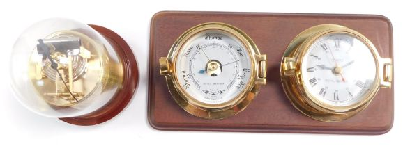 A Royal Mariner brass two dial wall clock and barometer, the clock with quartz movement, the case of