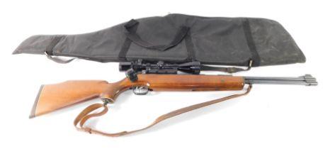 A Weihraeusch Sportwaffen .22 air rifle, with a 4x40 gun sight, cased.
