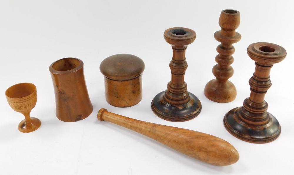 A group of treen, comprising a circular spice box and cover, three candlesticks, tapering vase, egg - Image 2 of 3