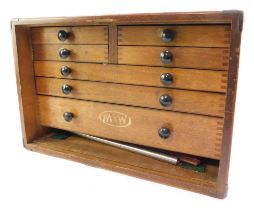 A Moore & Wright oak cased mechanical tool chest, containing micrometres, calipers and other precisi