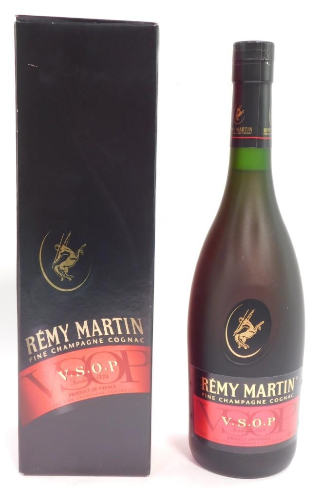 A bottle of Remy Martin VSOP Cognac, boxed.