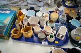 A quantity of small jugs, to include a Leonardo Collection character jug, Denby, Portmerion, Commemo