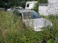 A group of five scrap vehicles. Peugeot 207 SW, registration KW07 PXX, Mondeo LX Estate, registrati