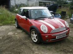 A Mini Cooper, registration AD54 MHM, 105,665 miles. Vehicle has been started and run around the ya