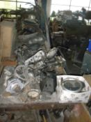 A quantity of chrome bumpers and grilles for classic cars and automobilia, gearboxes plus other part