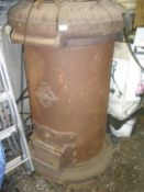 A large cast iron Fortnay & Sons cylindrical stove.