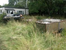 Two trailers and associated scrap there on and in between.
