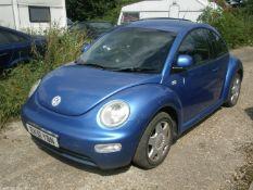 A Volkswagen Beetle, registration EK51 YBN, 115,206 miles. Vehicle has been started and driven arou
