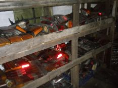 Classic car parts and automobilia, comprising rear light units and wheel trims, mostly from cars of