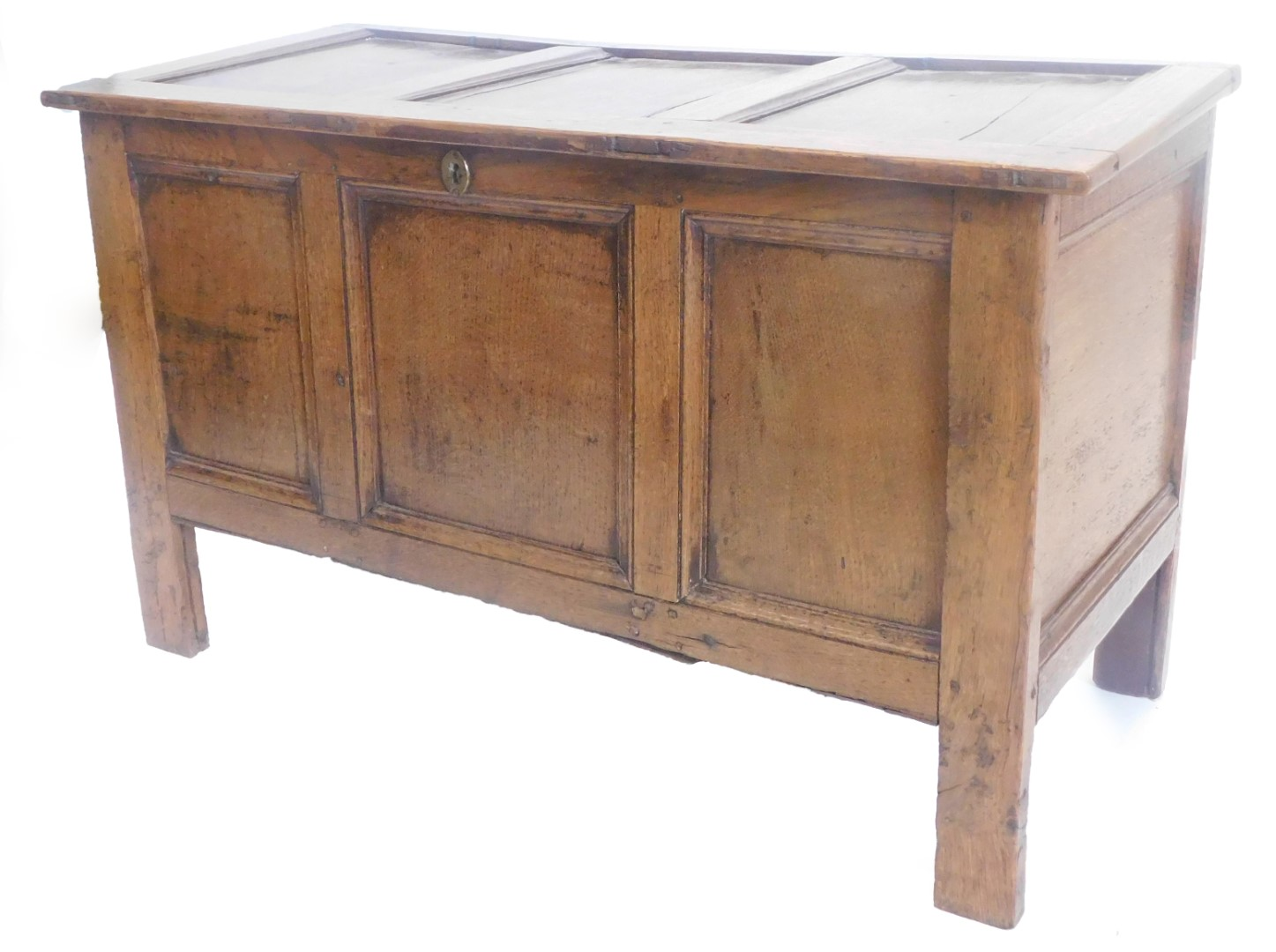 A late 17th/early 18thC oak triple panel coffer, on stiles, 106cm wide.