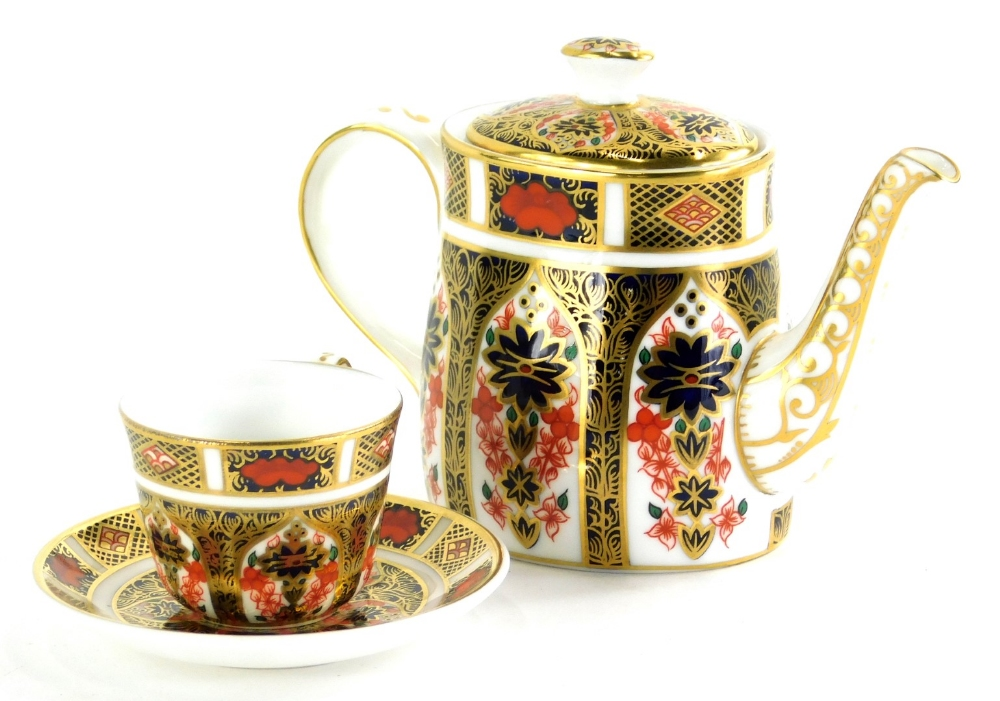 A Royal Crown Derby Imari pattern miniature trio, comprising teapot, 8cm high, cup and saucer. (3)