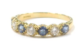 An 18ct gold sapphire and diamond dress ring, set with four round brilliant cut sapphires, each appr