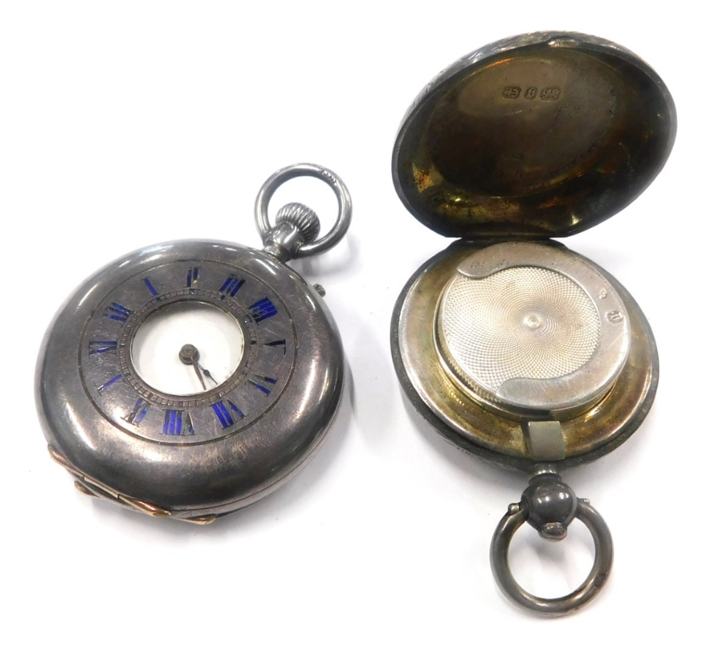 A silver fob watch, with outer case marked with blue enamel Roman numerals, and bearing figure of a