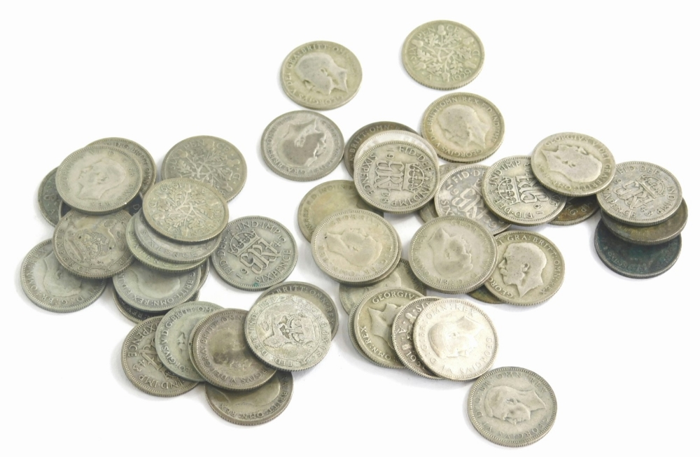Fifty pre 1946 sixpence coins, 135g.