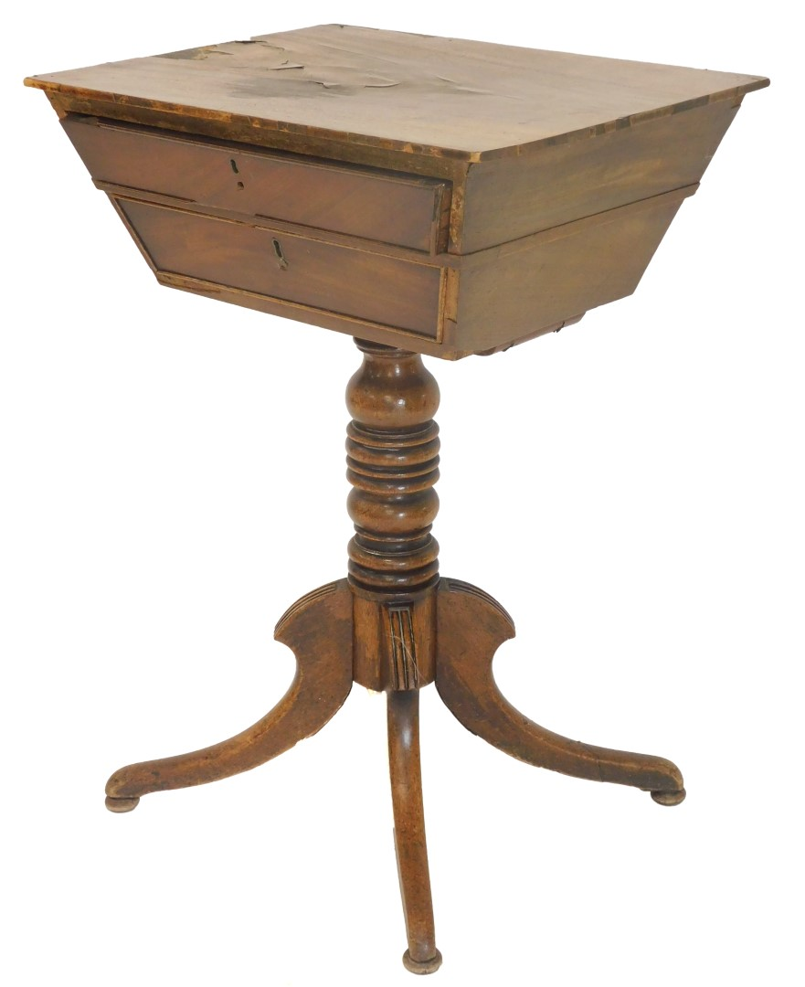 An early 19thC mahogany worktable, of tapering form with two drawers on a turned column, and splayed