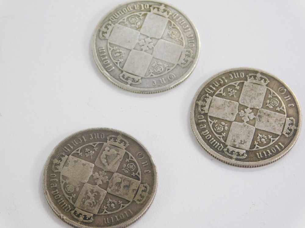 A small collection of coins, to include Victorian 1877 Gothic florin, 1876 Gothic florin and an 1877 - Image 2 of 2