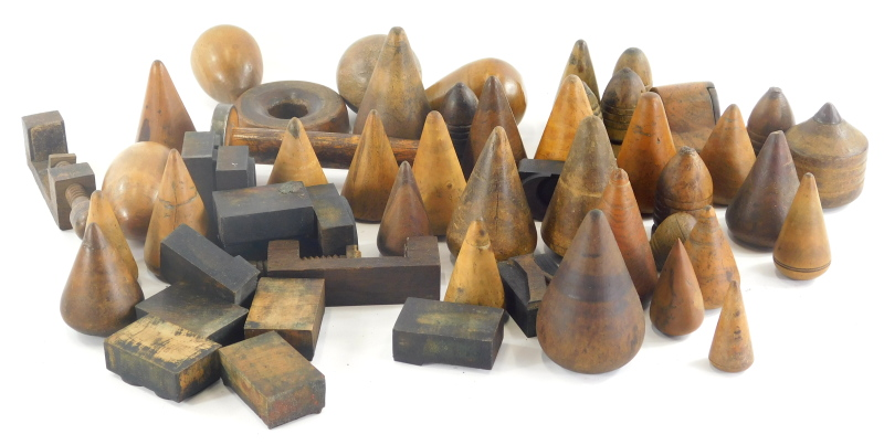 An interesting group of bygone treen spinning tops, various turned examples, 19thC and others, 7cm h