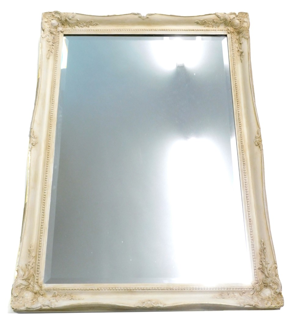 A cream painted wall mirror with bevel plate, 106cm high, 76cm wide.