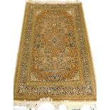 A Persian type mercerised cotton rug, with a central medallion, surrounded by an all over pattern of