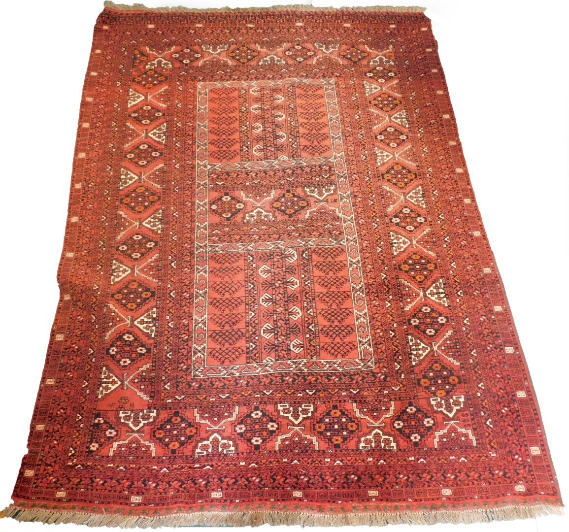 A Balouch type rug, with a design of medallions, on a red ground with multiple borders, 243cm x 171c