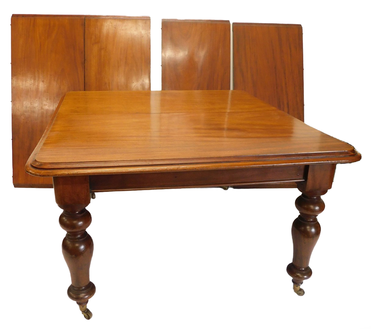 A Victorian mahogany extending dining table, the rectangular top with a moulded edge on turned taper