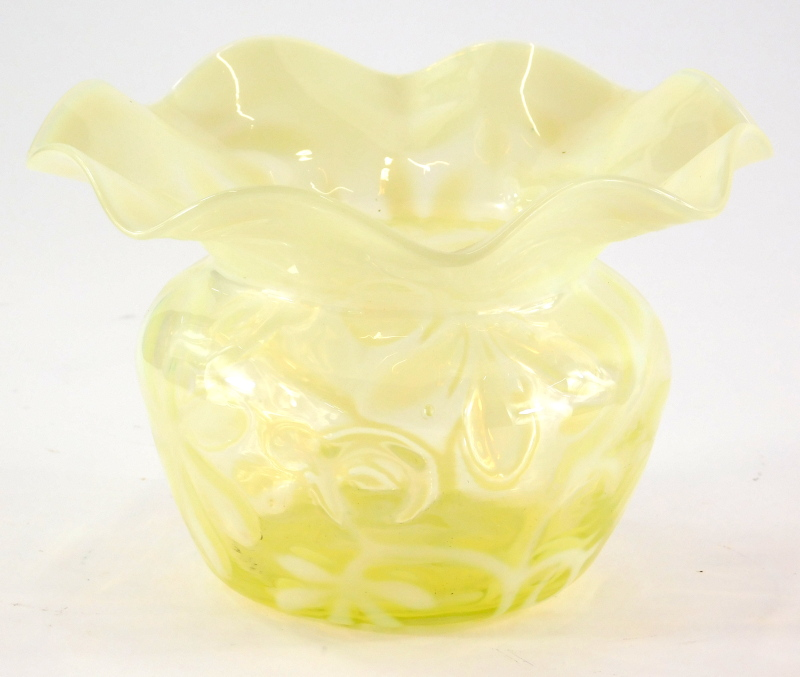 A Victorian vaseline glass vase, decorated with flowers, etc., 12cm high, 18cm wide.