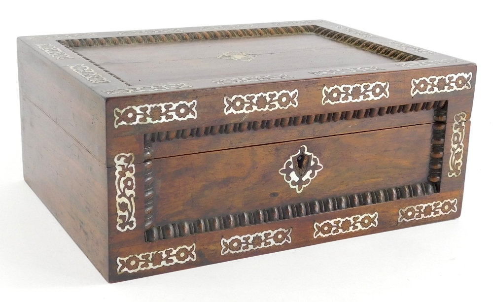 A 19thC mother of pearl inlaid jewellery casket, of rectangular form, the highly elaborate exterior,