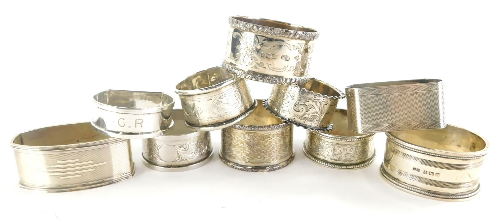 A collection of ten various silver napkin rings, early to mid 20thC, 5cm diameter, etc, 6oz all in.