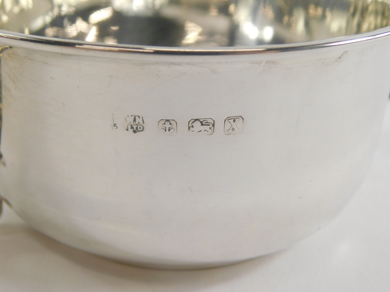 A George V silver two handled cup, of plain form with angular scroll handles each cast with an acorn - Image 2 of 2