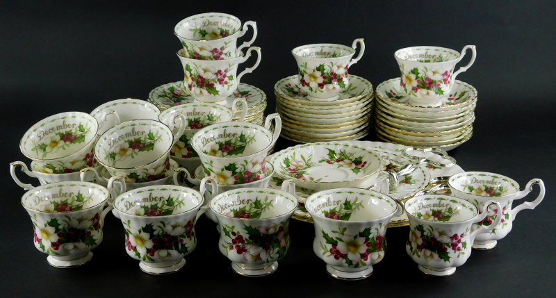 A Royal Albert Flowers of The Month December pattern part service, to include three tier cake stand,
