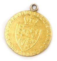 A George III 1789 spade guinea, 8.4g gross.