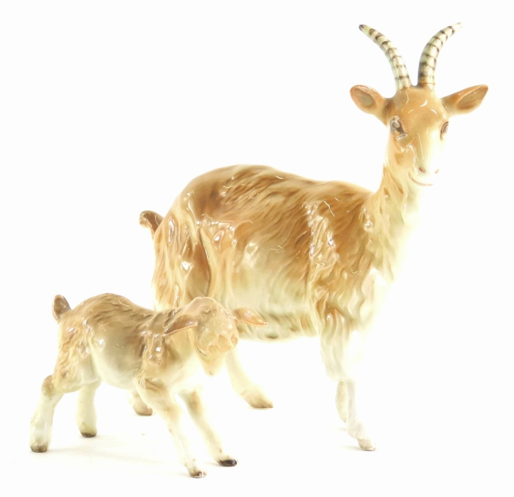 A Beswick ceramic billy goat and a kid. (2)