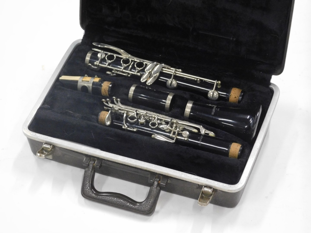 An Elkhart clarinet, in a fitted case.