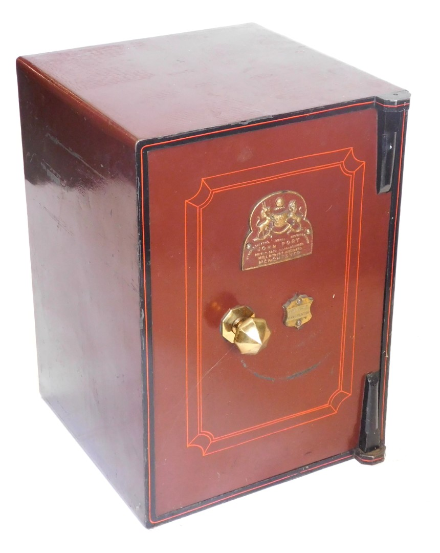 A John Port Manchester small cast iron safe, painted in red and black, 62cm high, 43cm wide.