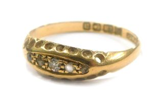 A three white stone gypsy set ring in 18ct gold, 1.9g all in.