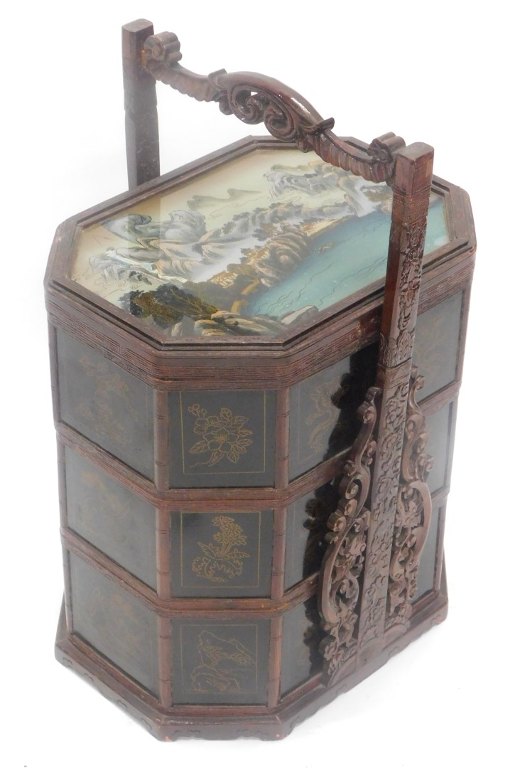 A oriental hardwood and lacquer sectional box, the reverse painted glass top decorated with building