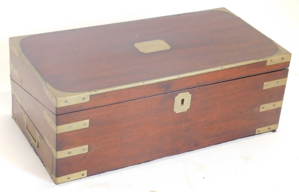 A 19thC mahogany and brass bound campaign writing box, the rectangular top engraved with cartouche E