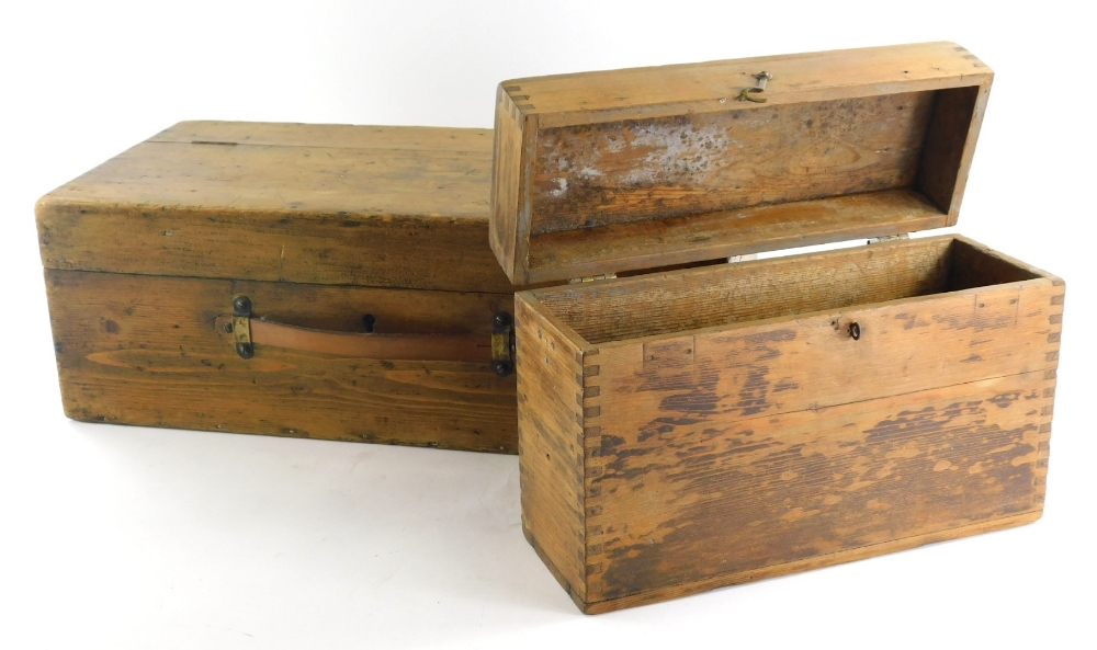 An early 20thC pine box, of rectangular form with hinged lid and plain interior, with leather strap