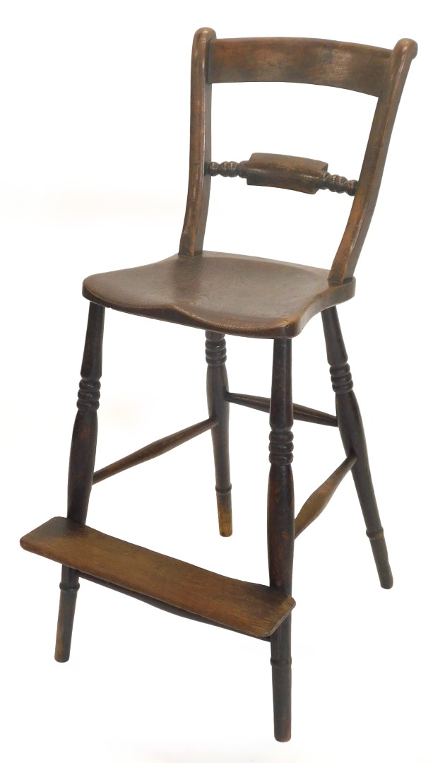 A 19thC Oxfordshire ash and elm bar back adult sized highchair, with turned legs and foot platform,